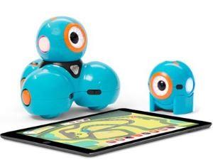 Dash and Dot sitting next to a tablet computer.
